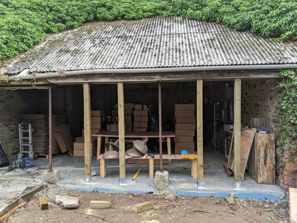 The barn, post cemented floor and pre new wall