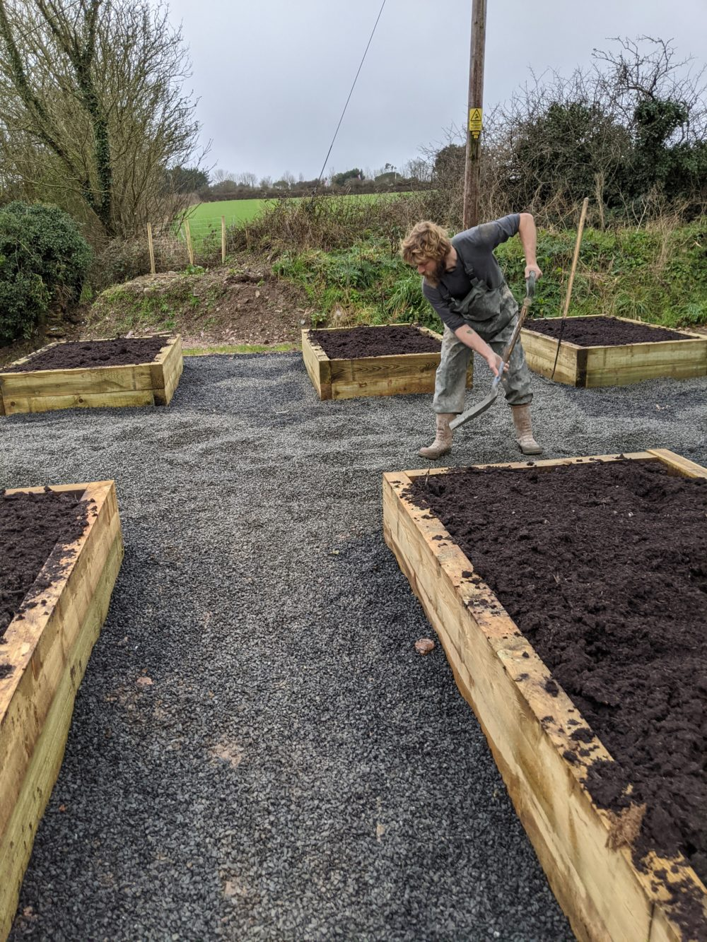 James finishing off the raised beds for vegetables as well as trials of flowers