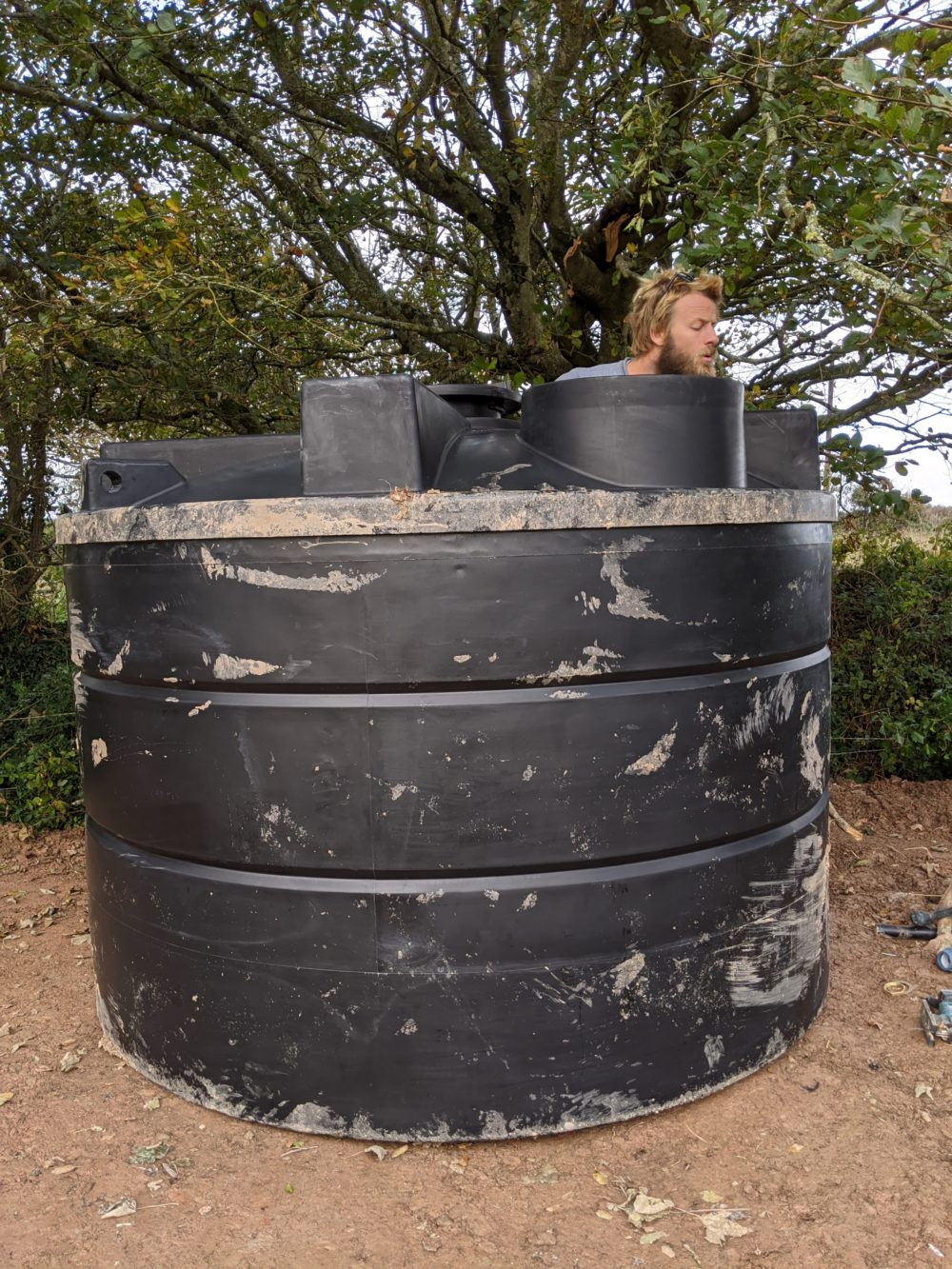James inspecting our 10,000 litre water tank