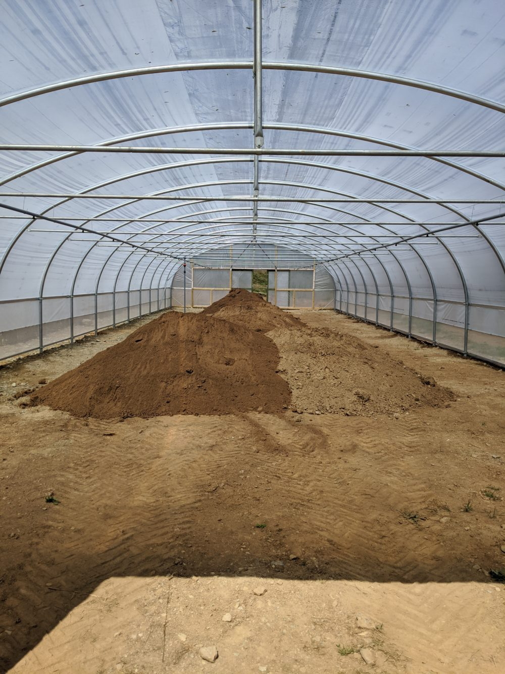 Polytunnel structures complete, now time to fill them!